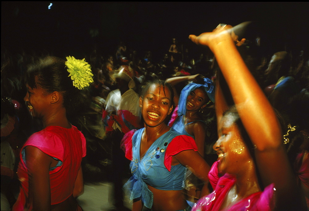 Dancers make their way down Av Victoriano Garzﺃ√ïºÙ£n in Santiago de Cuba during Carnaval.