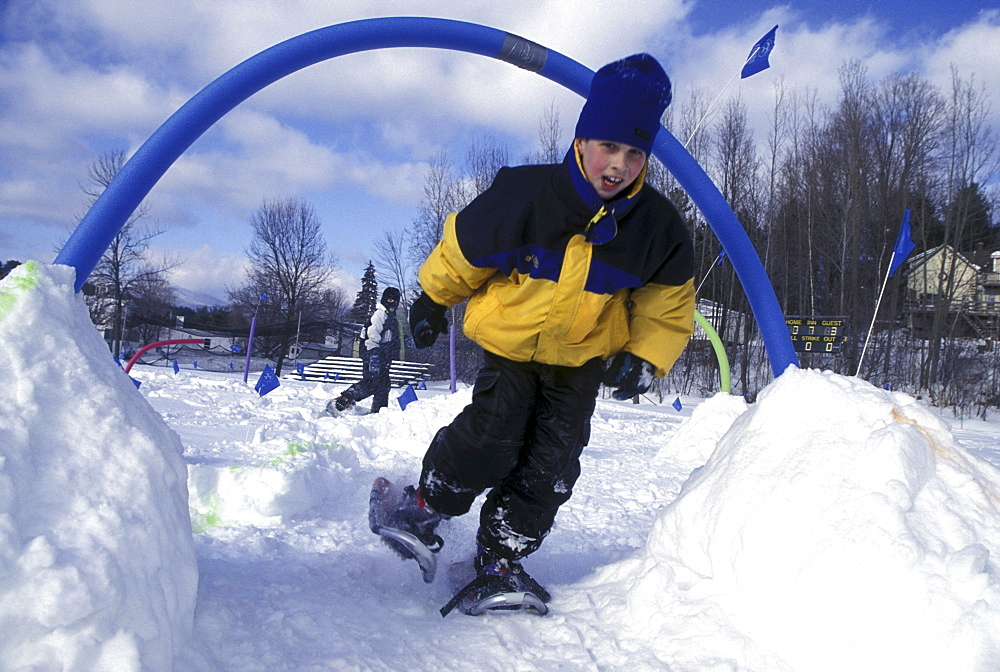 Young snowshoer in an obstacle course in Stowe, Vermont.