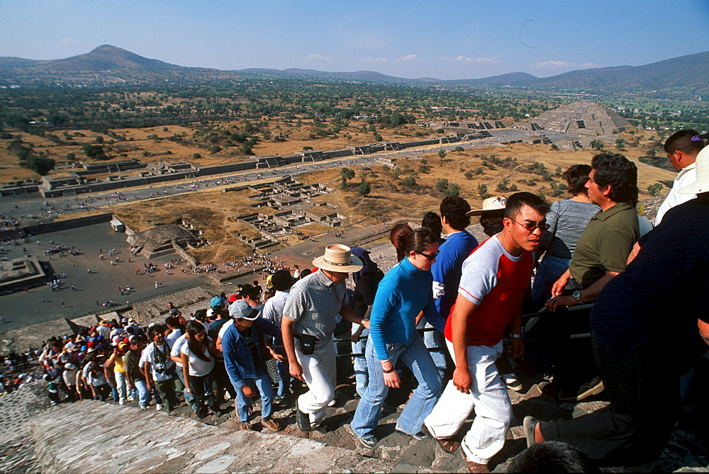 The Aztec pyramids of Teotihuacan were built in 400B.C. National monument located one hour North of Mexico City. The Pyramid of the Sun, largest of two, is considered by some to be a center of positive energy. Believers come to absorb the energy facing the sun. Another custom is to touch the center of the pyramid's summit where a small hole goes down to the center of the structure. Other people come to mimic others, and some just to enjoy the view.