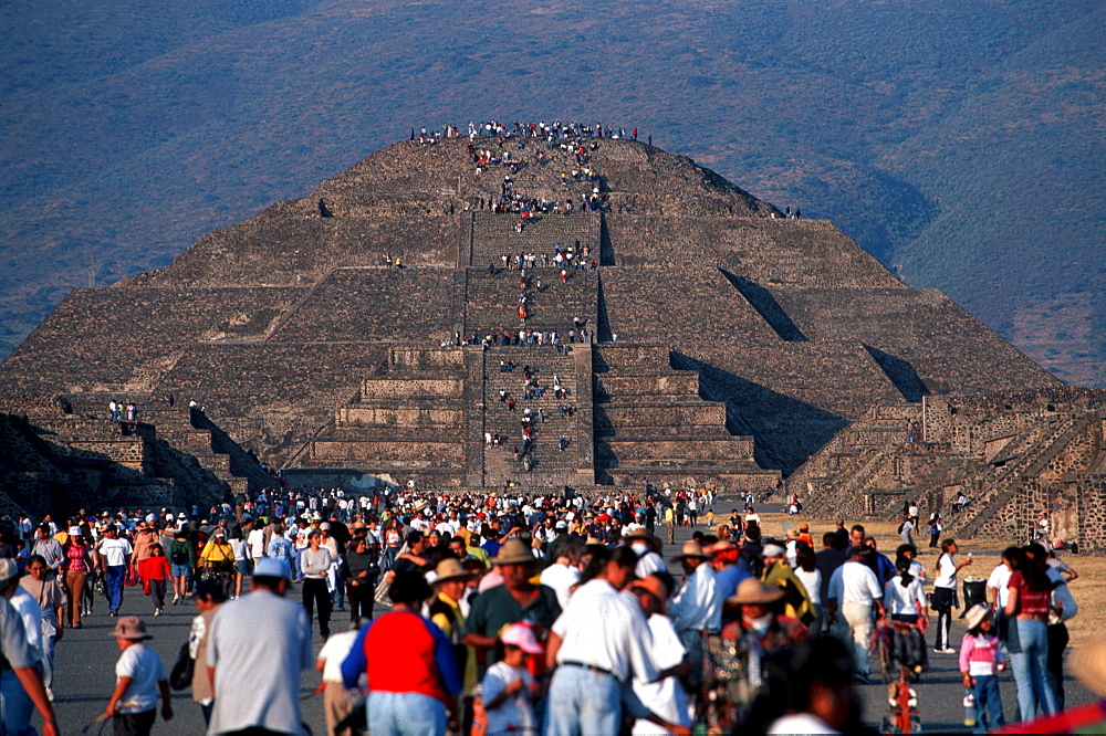 Pyramid of the Moon. The Aztec pyramids of Teotihuacan were built in 400B.C. National monument located one hour North of Mexico City. The Pyramid of the Sun, largest of two, is considered by some to be a center of positive energy. Believers come to absorb the energy facing the sun. Another custom is to touch the center of the pyramid's summit where a small hole goes down to the center of the structure. Other people come to mimic others, and some just to enjoy the view.