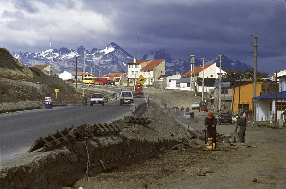 City crews in Ushuaia, Argentina, prepare to pave a dirt track in an fast-growing neighborhood.