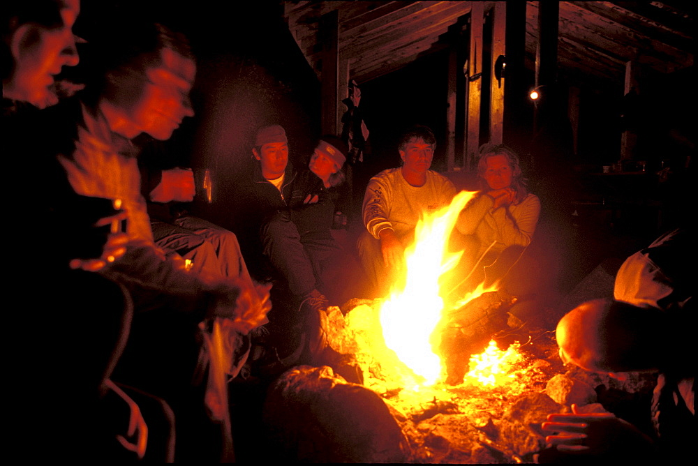 Group members relax around the campfire on the last night of the trip at Pointe a Passe-Pierre camp.