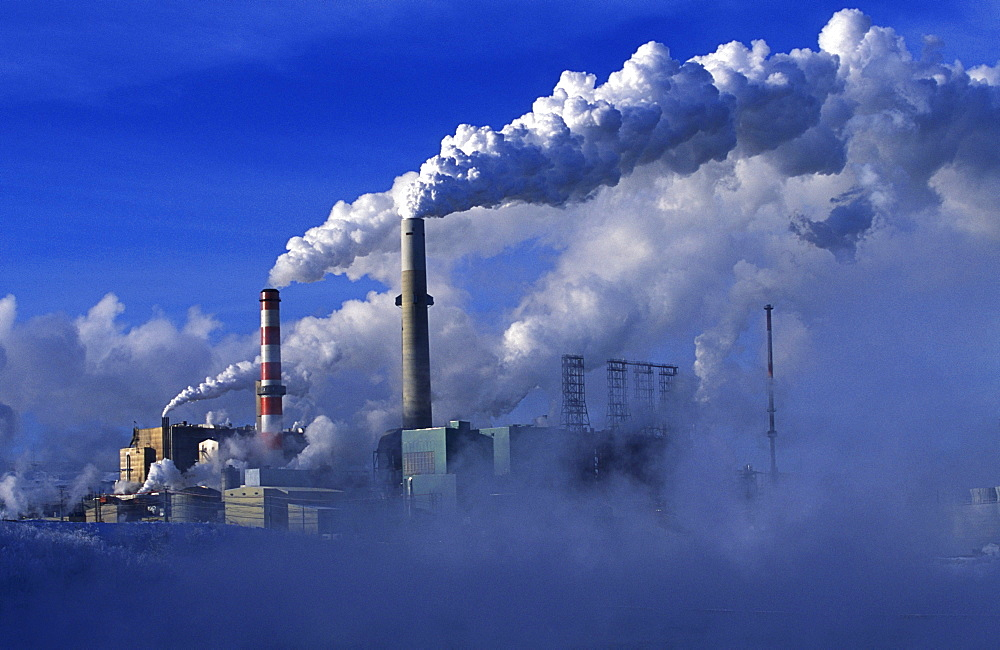 The Suncor oil sands plant in northern Alberta releases carbon dioxide into the air while processing oil.  - 857-16427