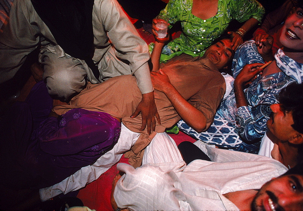 "Hijras attend a ritual birth ceremony whereby a Hijra ""mother"" gives birth to her ""daughter"""