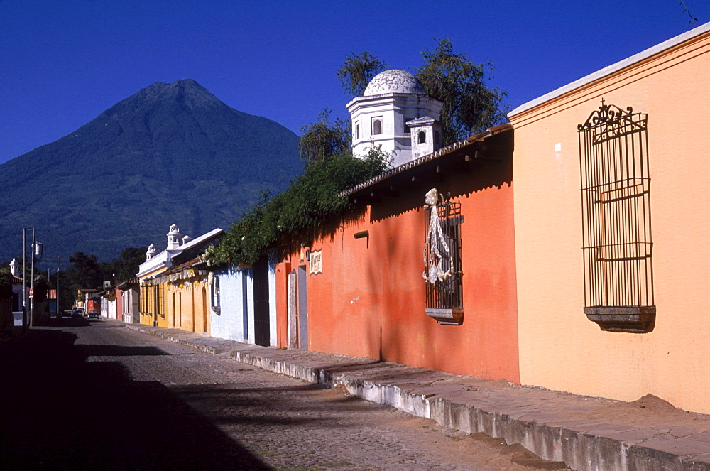 The colonial and colorful streets of Antigua, Guatemala attract tourists for romance and adventure as volcanoes and jungle surround the historic town, named a UNESCO site.