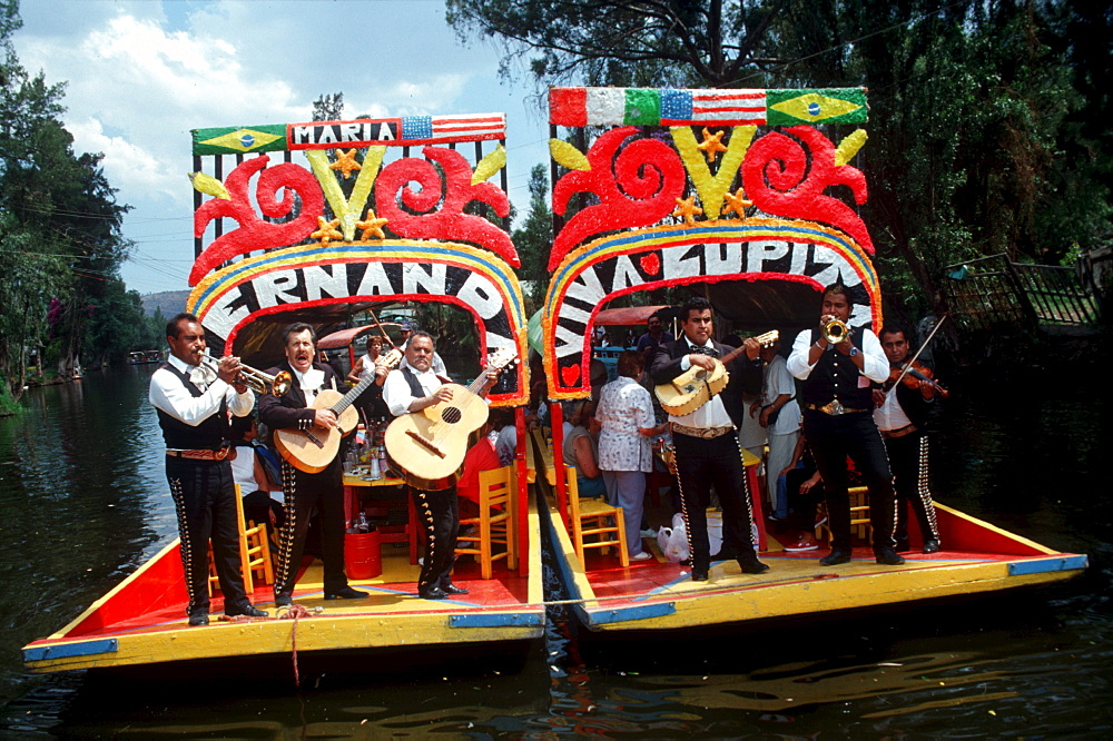 UNESCO patrimony site Xochimilco, features 'trinjeras', brightly-painted gondolas, which passengers and tourists hire to be poled around the canals of the region. Passengers can hire mariachis from passing boats, and buy food, drinks, and folk arts. The canals were part of an ancient irrigation and waterway system. Xochimilco was the original name of the area that is now Mexico City.