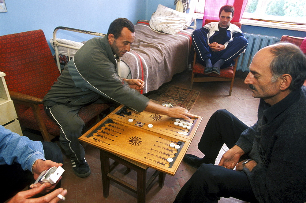 Men with the MDR (Multi Drug Resistant) form of tuberculosis, play backgammon in one of their rooms in Gulripsch Hospital, Abkhazia.