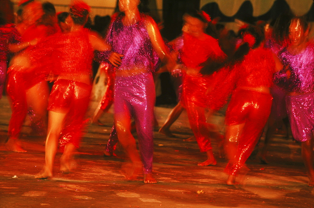 In Tahiti, hundreds of traditional dancers perform in the streets of Papeete the capitol during a Halloween celebration.