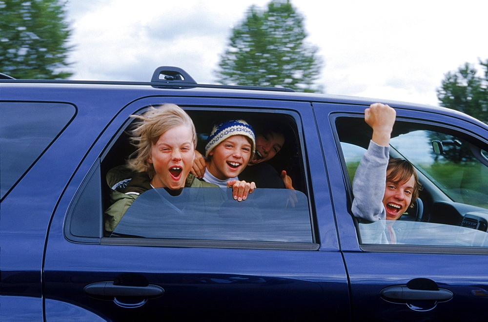 Burton Snowboards Youth team on a roadtrip in Oregon. Kids playing in car.
