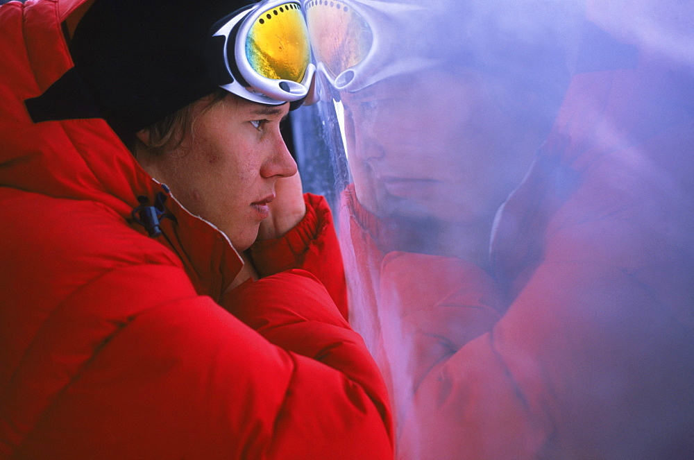 Snowboarder Heikki Sorsa stares out of foggy gondola window