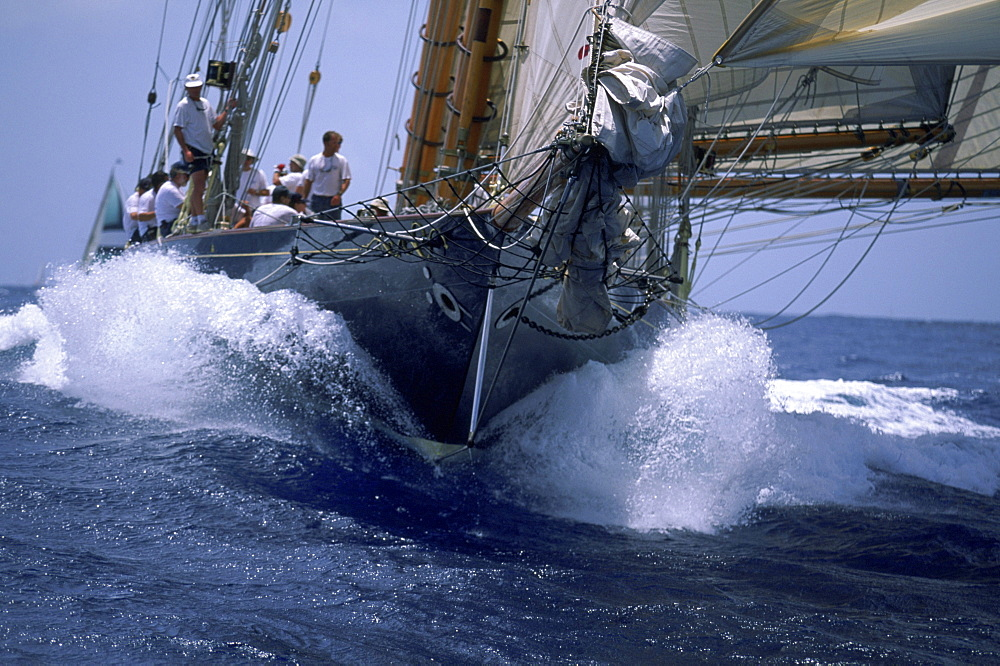 The crew of a 109 foot Herreshoff schooner, a classic racing yacht, sail toward the finish.
