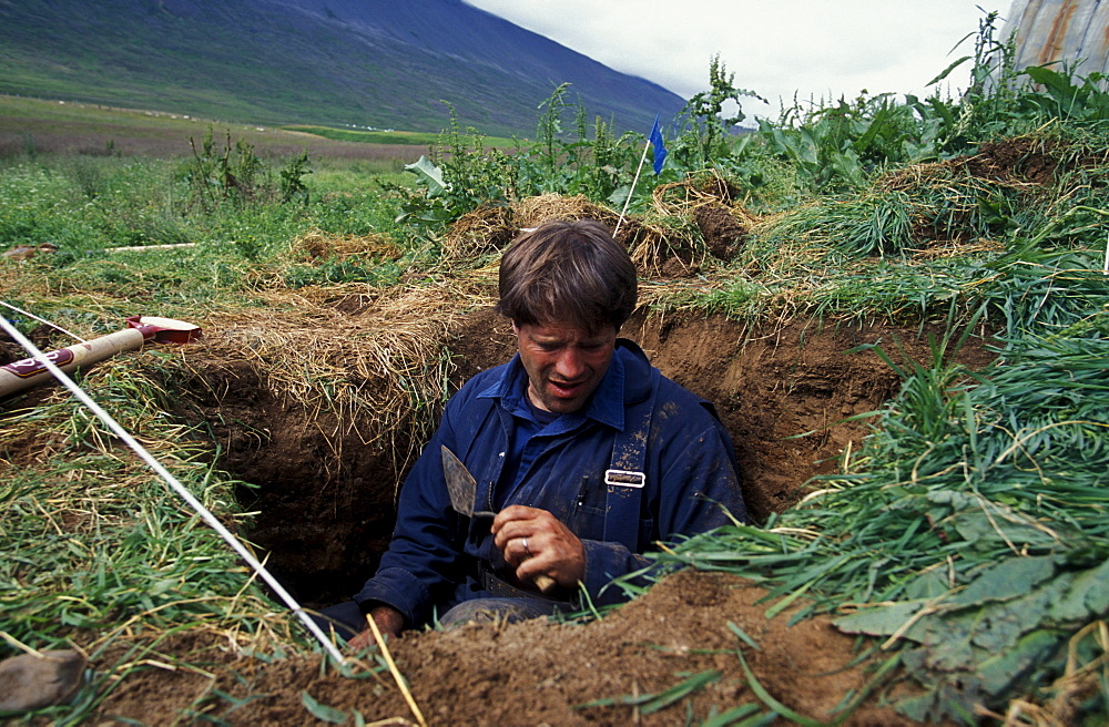 American archeologist John Steinberg examines a test pit in a farmer's field near Glaumbaer in northcentral Iceland. Steinberg made an important discovery in Glaumbaer in 2001. He found the homestead of Thorfinn Karlsefni, the father of the first European born in the New World. This find has important implications for Viking history.