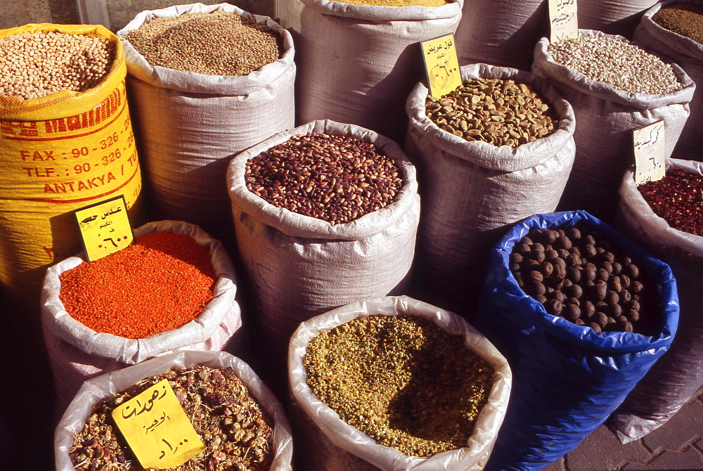 Jordan, The Middle East, Sacks of Spices, Beans and Herbs, inside the Souk in downtown Amman.