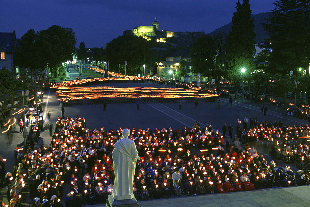 Catholic pilgrims march in a candlelight procession to Mass at the Sanctuary of our Lady of Lourdes. On this site, 14-year-old Bernadette Soubirous had a vision of the Virgin Mary in a grotto near Lourdes, France in 1858.