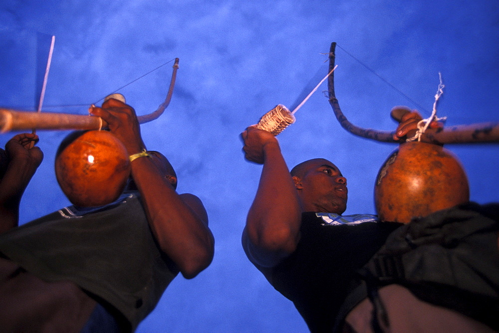 In the small village of Itacare, two Capoeira musicians play the birimboa, a gord and string instruments used for rhythem in the Brazilian martial art-like dance, that originated with slaves in Bahia.