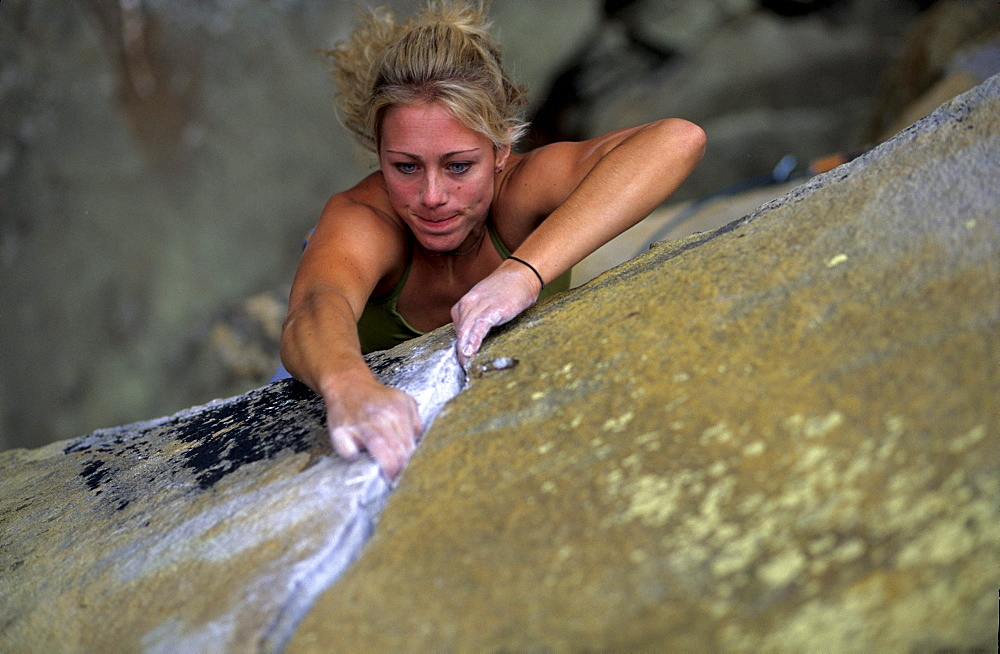 Jennifer Jenkins eyes blaze as she jams her fingertips into a crack at The Little River Canyon in Alabama.