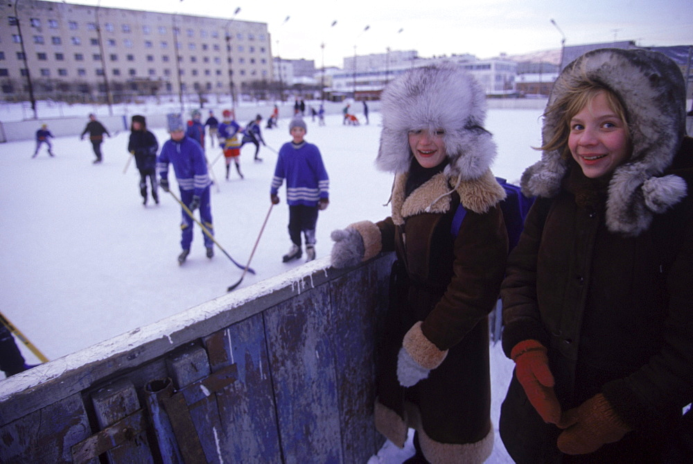Children play and watch ice hockey in the town of Magadan located in the far east region of Siberia.