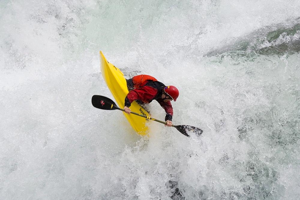 "Young man (Trip Jennings) performs ""freewheel"" move over Kootenai Falls on Kootenai River near Libby, Montana"