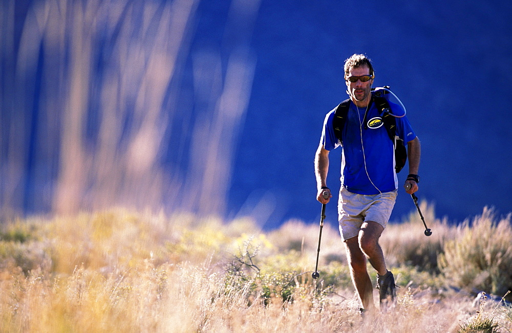 Russ McBride trail running with trekking poles for his endurance training in the Buttermilks outside of Bishop, California.