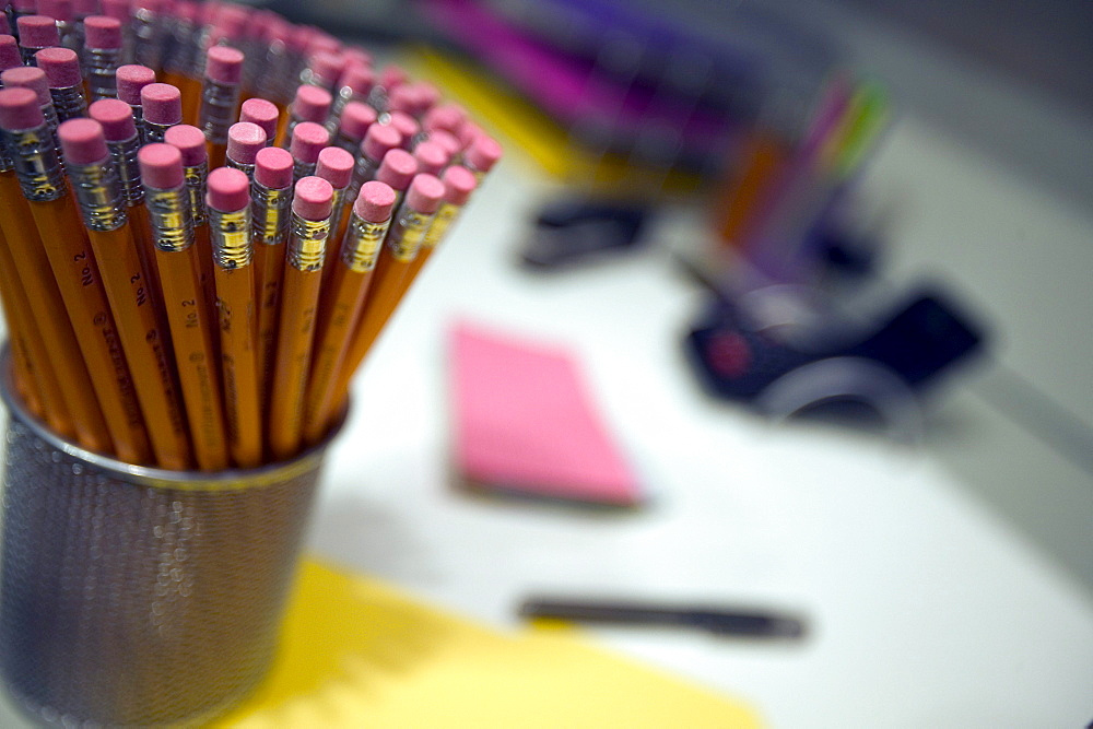 Stack of pencils on an office desk.