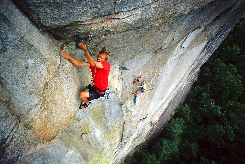 Matt Floyd on the crux roof pitch (5.12+) of The Glass Menagerie on the North Side of Looking Glass Rock near Brevard, NC
