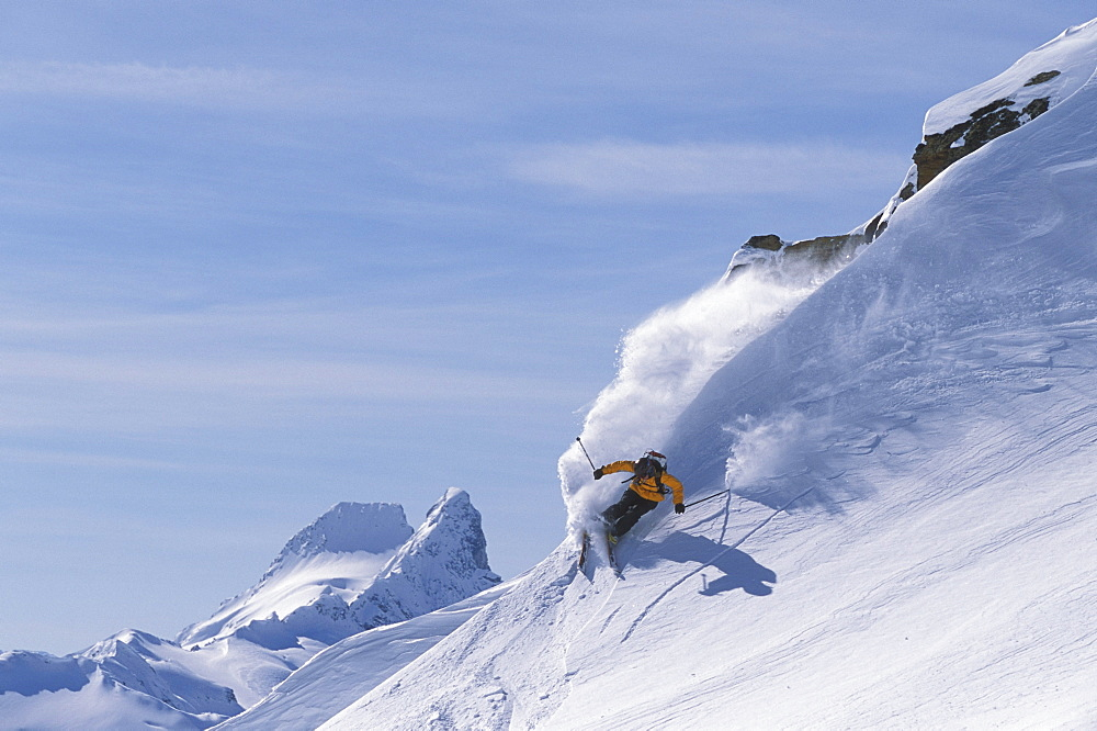 Female skier (Sarah Oakden) skiing at Mica Helisking near Mica Creek, BC, Canada