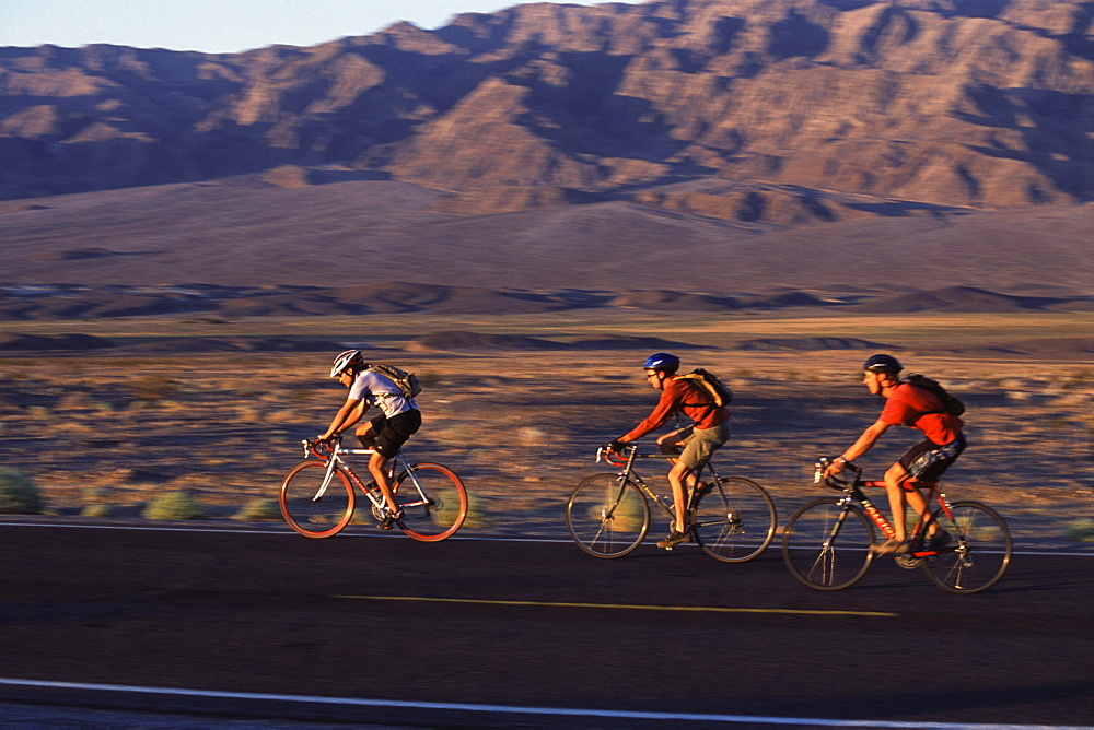 3 cyclists riding in Death Valley, California.