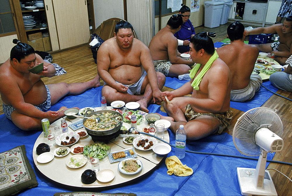 Eating breakfast at Sumo stable, Tokyo, Japan.