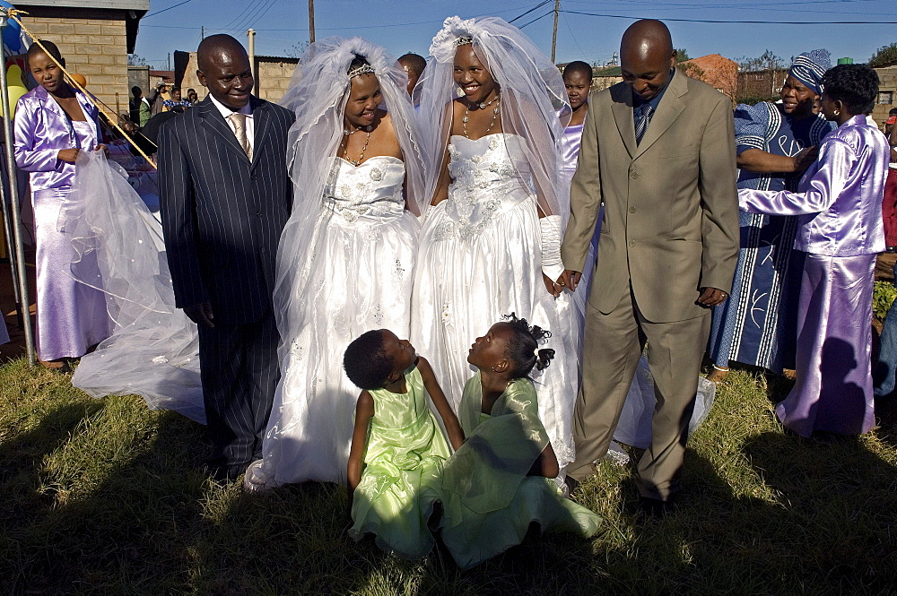 Roselane Madubedube (left) is one of twin brides, marrying husband Ignatius Sefafe Mokhomo. Her sister, Rose Mabale Seqhomoko and new husband William are also in the photograph, taken at their double wedding in Maputsoe, Lesotho.