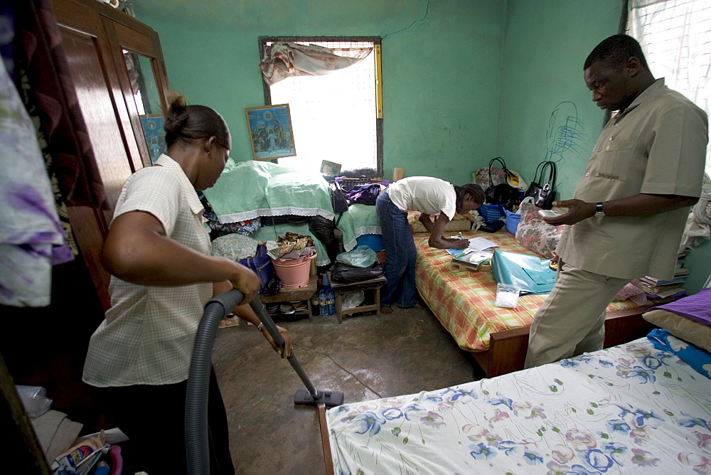 Research assistants and technicians from the University of Ghana collect dust samples from the living rooms and bedrooms of  children in Accra, Ghana.  The samples will be analyzed for the presence of dust mites, fungus', and animal allergens to help rese