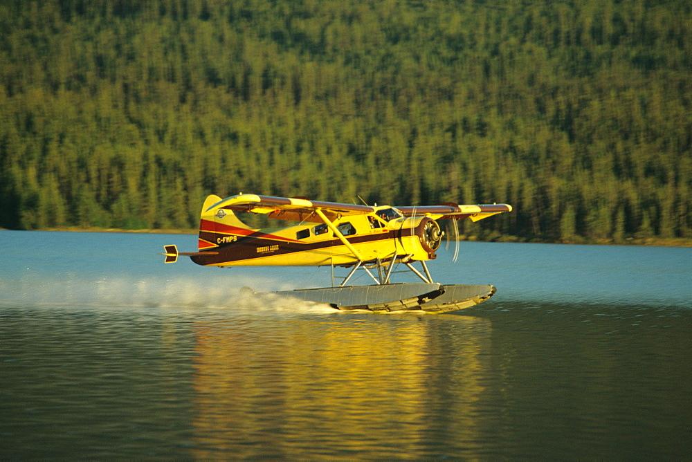 The Inconnu Lodge's DeHavilland Beaver floatplane takes off from McEvoy Lake in Canada's Yukon Territory.