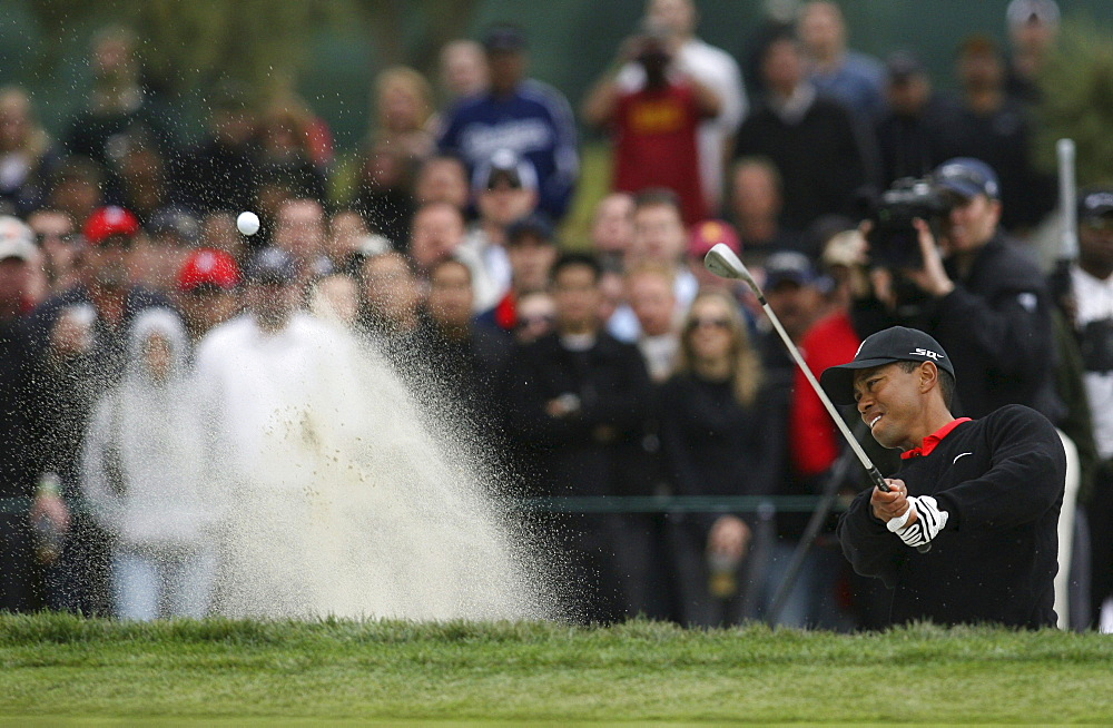 Tiger Woods hits from sand trap