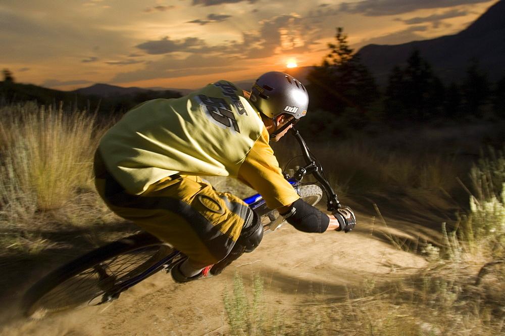 A mountain biker at sunset in Kamloops. British Columbia.