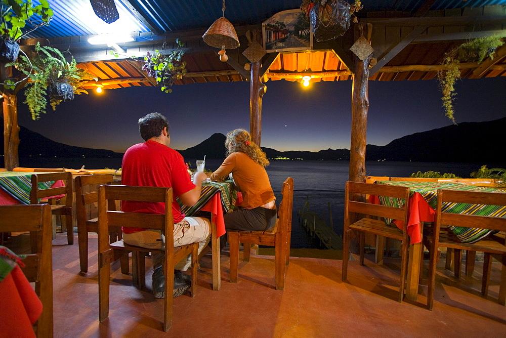 A couple eating dinner in Panajachel, Gautemala.