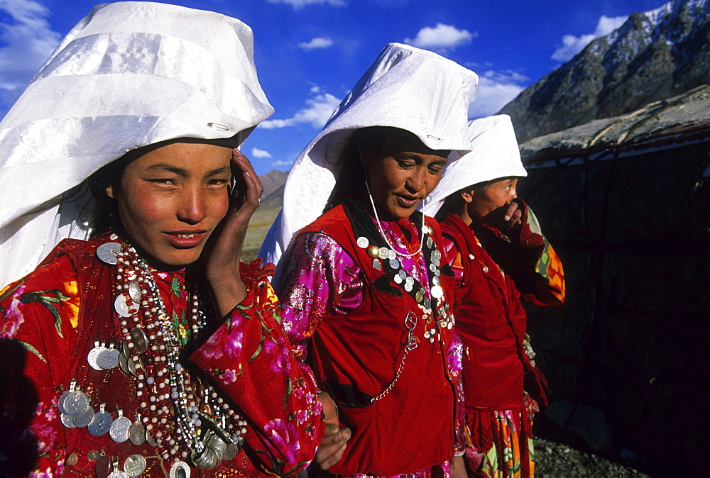 Kirghiz women in traditional dress outside of their yurt camp, Little Pamir, Wakhan, Afghanistan