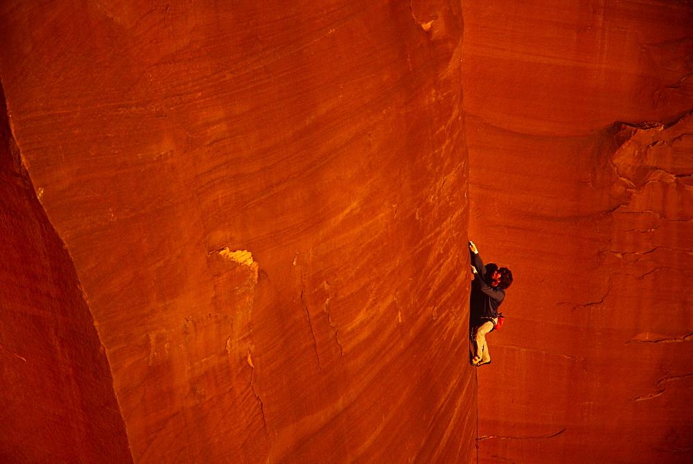 man rock climbing, San Rafael Swell, Utah