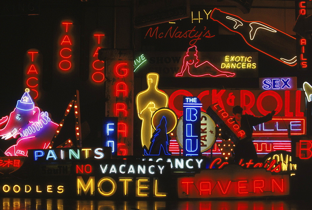 Scott Young moving a sign at 'Nights of Neon'- a neon production company that manufactures and rents neon signs to the film industry.