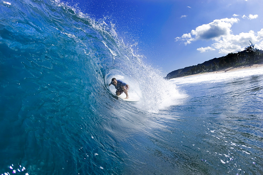 Music Star; Jack Johnson surfing in Hawaii
