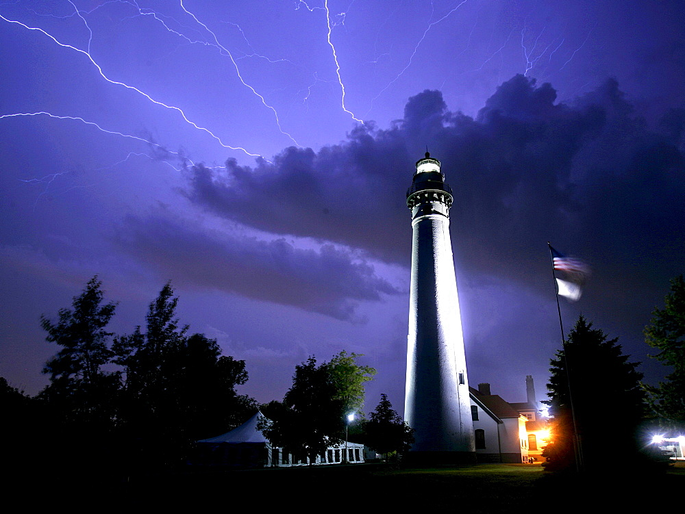 Lightning streaks across the sky near the Wind Point Lighthouse in Racine, Wis. It is one of the tallest and oldest that is still active on the Great Lakes.