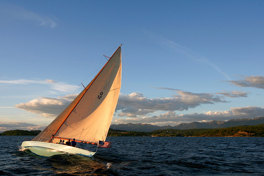 Guest at The Flathead Lake Lodge near Bigfork, Montana sail on the Questa a 51' Q-Class racing boat build in 1928.