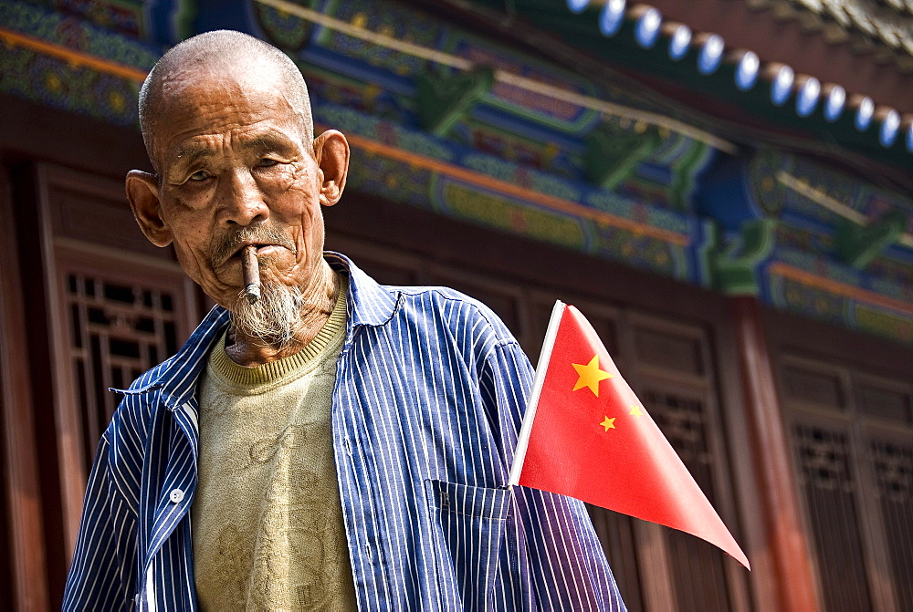 Old local Smoking a cigar, Xian, Shaanxi Province, China
