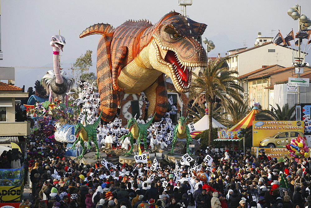 Masks and caricatures of politicians singing and dancing in the streets and enormous paper mache floats, surrounded by thousands of people, in the great celebration of the Carnival of Viareggio. - 857-48873