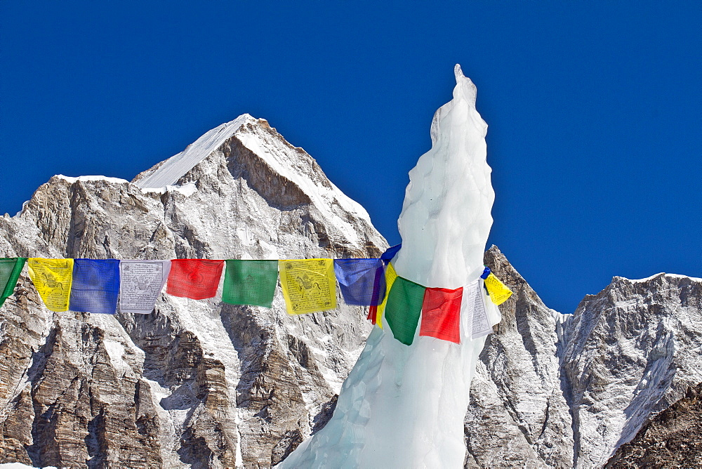 A prayer flag attached to a ice pinnacle at Everest Base Camp