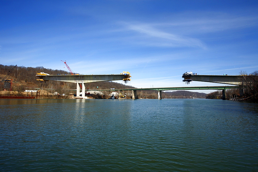 Water-level view of the new I64 bridge under construction over the Kanawha River in downtown Charleston, WV.