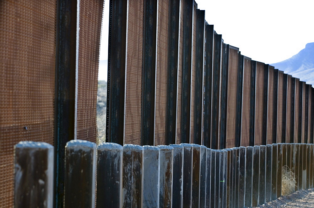 Mexicans cut a panel from the pedestrian fence on Mexican border, AZ.
