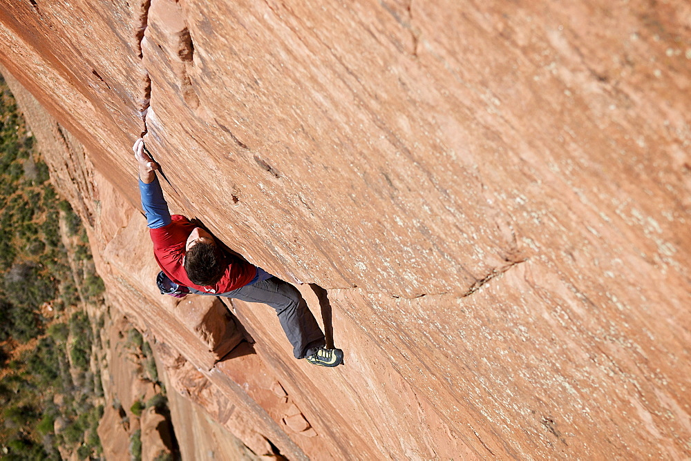 A man rock climbing in Zion National Park, UT.