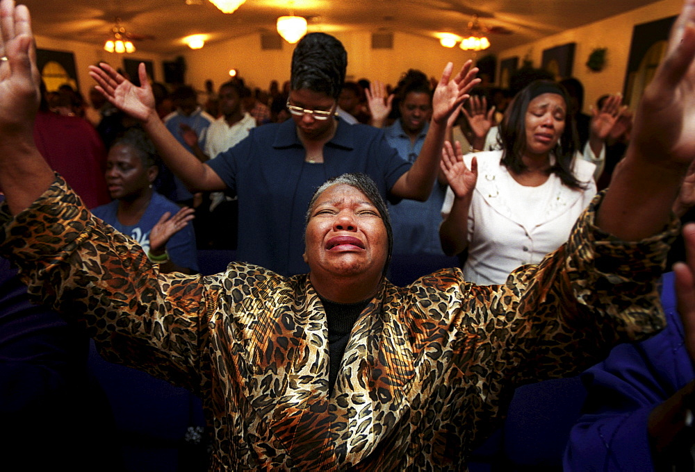 Church members worship at a Sunday morning service. - 857-51773
