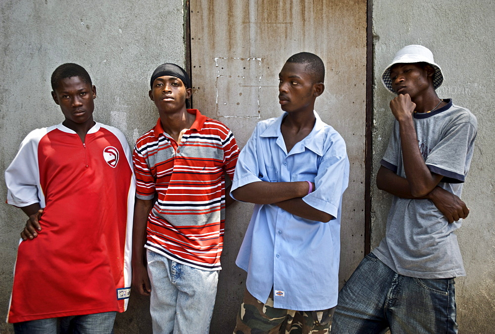 Young rap kreyol artists wait outside a recording studio in Port-au-Prince, Haiti.
