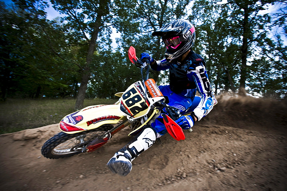 Motocross biker leans into a sharp turn in Brainerd, Minnesota.