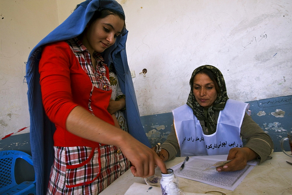 A young woman prepares to vote for presidential and provincial candidates in national elections, Sultan Razia Girls High School, Mazar-i Sharif, Afghanistan on August 20, 2009.